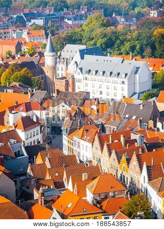 Aerial view of narrow streets and red rooftops of Bruges, Belgium.