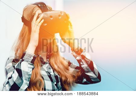 Blonde girl in glasses and mask for BP. Corrects glasses. With a sunlight and toning. The concept of virtual reality.high contrast