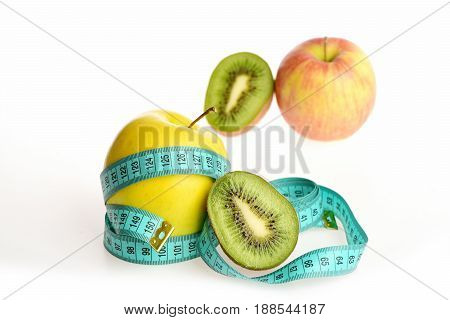 Apple Half Of Kiwi Wrapped With Measuring Tape