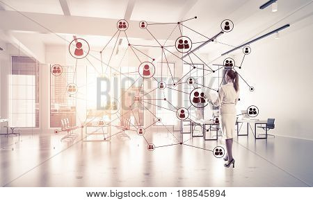 Elegant businesswoman in 3D office interior and social connection concept. Mixed media