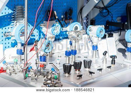 Pressure gauge, measuring instrument close up. Modern
