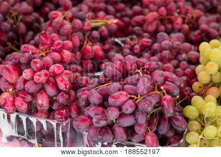 Purple Grapes On The Market, Of The Variety Red Globe Seedless. Top View. Close-up