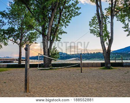 Volleyball net on the sandy lake beach