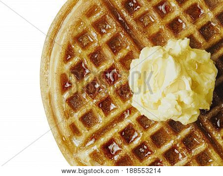 close up of traditional classic belgium american waffle with butter and maple syrup