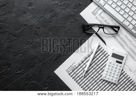 business taxes accounting in office work space on dark desk background top view mockup