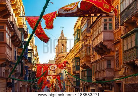 Festively decorated street in the old town of Valletta, Malta