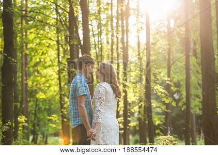 Portrait of a young romantic couple embracing each other on nature.