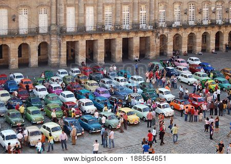 Car enthusiasts admire vintage Seats in front of the Palace of Raxoi in the Obradoiro Square - Santiago de Compostela Galicia Spain, 13 October 2007