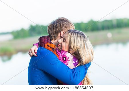 beautiful young couple in love dating near the lake.