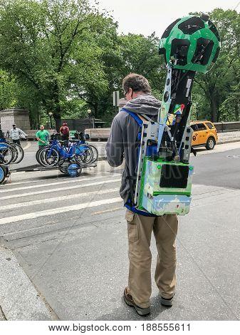 New York May 23 2017: Google Street View camera operator is waiting to cross 59th street at Columbus Circle.