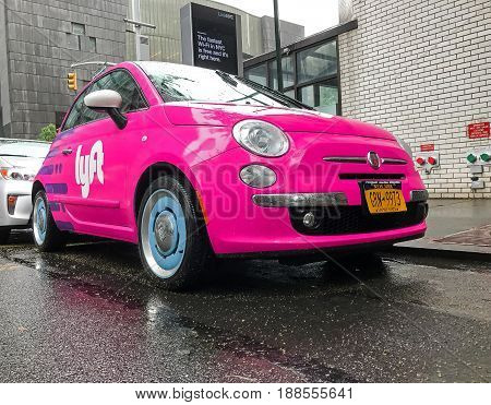 New York May 25 2017: Fiat 500 painted pink and carrying a Lyft logo is parked in the streets of Manhattan.