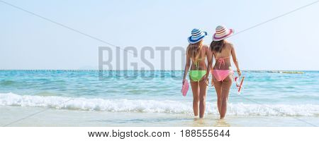 Beach vacation snorkel girl snorkeling with mask and fins. Bikini woman relaxing on summer tropical getaway doing snorkeling activity with snorkel tuba flippers sun tanning. Banner crop for copy space
