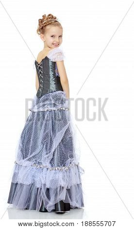 Slender little girl , with beautiful hair on his head, elegant long Princess dress.The girl twisted to the side and keeps his hand on his knee.Isolated on white background.