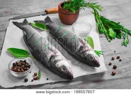 Cutting Cooking Raw Two Fish Trout On Paper