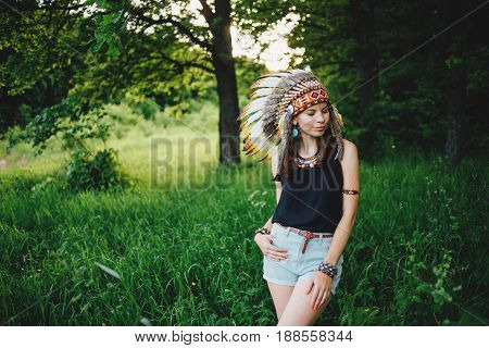Young Girl In An Indian Roach In The Forest