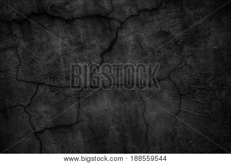 Black Concrete Wall Covered With Cracks. Gloomy Surface Of The Cement Board