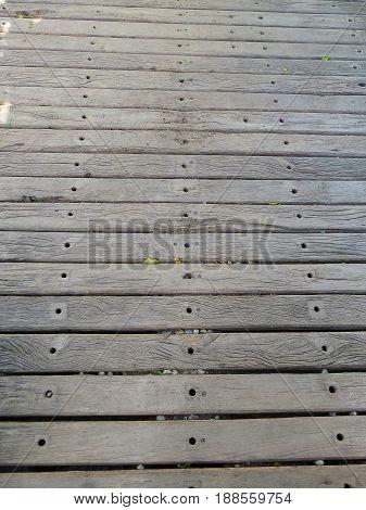 Old rustic floor of horizontal parallel wooden boards, textured, in gray color