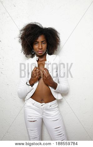 Sexy woman posing in white clothes on a white background