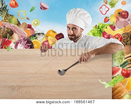 Smiling chef with ladle indicates a board and vegetables background