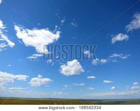 blue sky and white clouds over the prairie