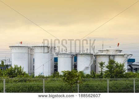 The big white industrial tank and the shading sky.The group of big container tank