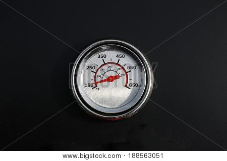 Thermometer BBQ cooking red arrow on black background