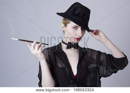 Young blonde woman with hat and with mouthpiece