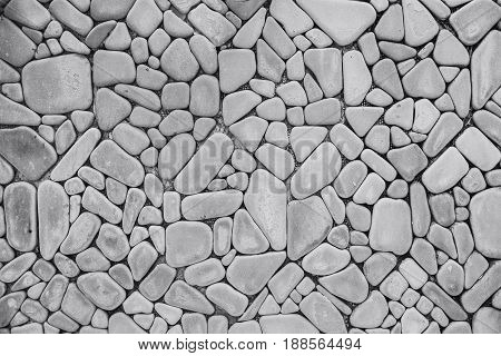 Round Curved Rock Wall Background. Stone Decoration Wallpaper Tile Black And White Texture Pattern.