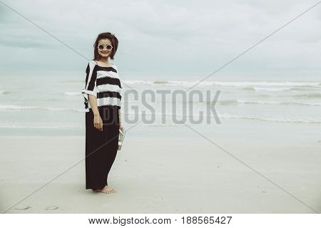 Portrait Asian Single Hipster Indy Women Wear Sunglasses Lonely Stand Alone On The Beach Vintage Mut
