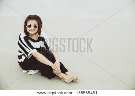 Portrait Asian Single Hipster Indy Women Wear Sunglasses Lonely Siting Alone On The Beach Vintage Mu