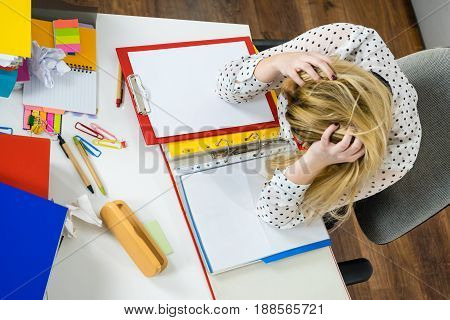 Depressed Businesswoman Sitting At Desk