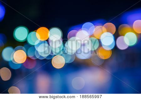 city blur bokeh vibrant vivid night life colors. colourful midnight light decoration background blue tone.