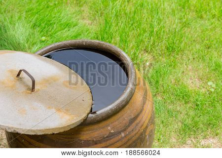 Rain water keeping in jar Thai tradition home style.