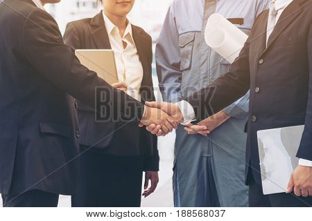 Businessmen Handshake With Business Team Background