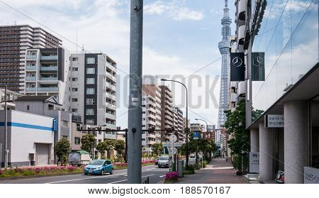 Tokyo Japan - May 4 2017: Cars are travelong on the street that lead to Tokyo Skytree.