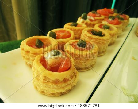 smoked salmon roulade with and horseradish cream sauce in on shelf in bakery or baker's shop