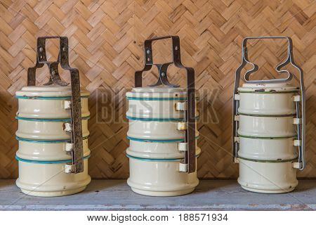 three of tiffin carrier ware Food boxes.