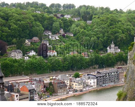 Stunning view of the vintage buildings along Meuse river and on the hillside, Dinant, Wallonia Region, Belgium