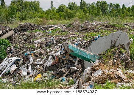Illegal garbage dumping outside near the forest