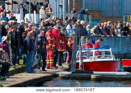 BERLIN GERMANY - MAY 03 2014: Motor boat rescue service and the spectators on the waterfront. 2nd Berlin water sports festival in Gruenau