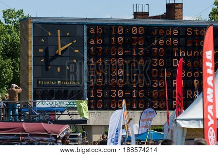 BERLIN GERMANY - MAY 03 2014: Electronic scoreboard with a schedule of performances of the festival. 2nd Berlin water sports festival in Gruenau.