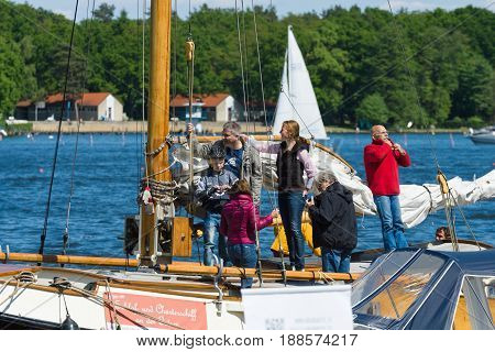 BERLIN GERMANY - MAY 03 2014: Visitors and guests of the festival visiting the sailing yacht. 2nd Berlin water sports festival in Gruenau