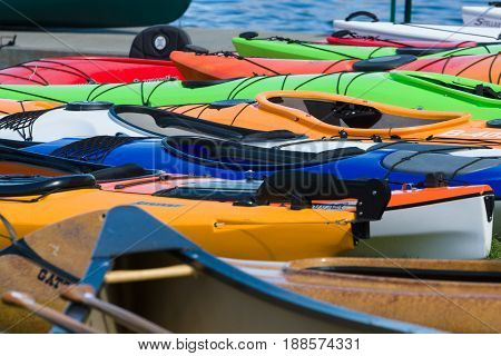 BERLIN GERMANY - MAY 03 2014: Sport boats kayaks and canoes at the marina. Background. 2nd Berlin watersports festival in Gruenau on the river Dahme tributary of the river Spree