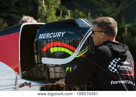 BERLIN GERMANY - MAY 03 2014: A technician prepares a speedboat Formula 1 for the demonstration races. 2nd Berlin watersports festival in Gruenau on the river Dahme tributary of the river Spree