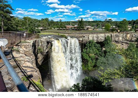 Gadsden Alabama USA - May 25 2017: Noccalula Falls after a storm system passed through earlier in the week. The falls cascades roughly 90 feet into the Black Creek ravine.