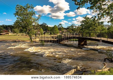 Gadsden Alabama USA - May 25 2017: Noccalula Falls Park after a storm system passed through earlier in the week. City of Gadsden Parks & Recreation operates this park located on land once owned by R.A. Mitchell a former mayor of Gadsden.