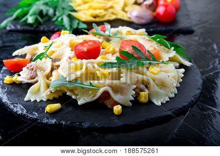 Pasta Salad In Slate Plate With Tomatoes Cherry, Tuna, Corn And Arugula. Ingredients. Italian Food.