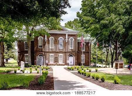 Loudon Tennessee USA - May 25 2017: Historic Loudon County Courthouse which was built in 1872 and is still in use today. Loudon County is one of the youngest counties in Tennessee. It was created in 1870 from parts of Roane Monroe and Blount Counties.