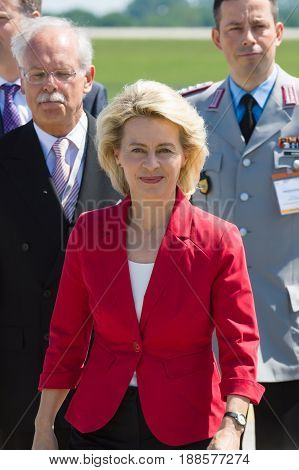 BERLIN GERMANY - MAY 21 2014: Arrival of the Federal Minister of Defence of Germany Ursula von der Leyen at the exhibition ILA Berlin Air Show 2014