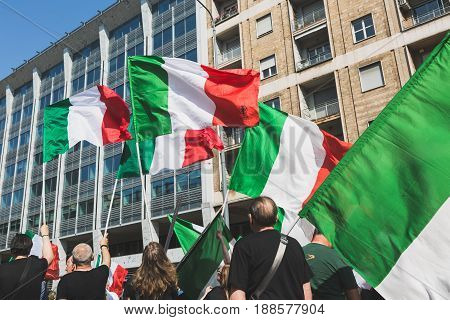 MILAN ITALY - MAY 27 2017: Far-right activists march in the city streets protesting against the rampant immigration and demanding more support for Italian citizens.